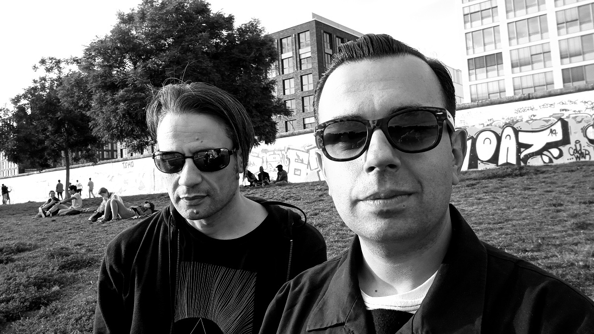Left Nick Drivas (Das Noir), right Nikolaos Raptis (Fringe Society) at The East Side Gallery, Berlin. Summer 2019. Photo: Marily Kitsiona.